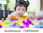 little girl playing with... | Shutterstock . vector #718934644