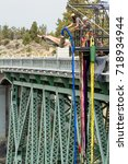 Small photo of Peter Skene Ogden State Park, Oregon - September 02 :People experiencing a thrill and adrenaline rush by bunker jumping off the bridge. September 02 2017, Peter Skene Ogden State Park Oregon.