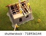 miniature construction workers | Shutterstock . vector #718936144