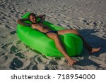 Small photo of Happy man relaxin in the green air sofa called lamzac.