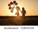 silhouette of two happy... | Shutterstock . vector #718955254