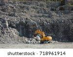 large jackhammer smashing rocks ... | Shutterstock . vector #718961914
