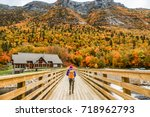 autumn nature hiker girl... | Shutterstock . vector #718962793