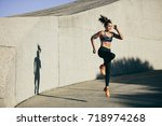 fitness woman doing cardio... | Shutterstock . vector #718974268
