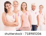 women wearing pink shirts and... | Shutterstock . vector #718985206
