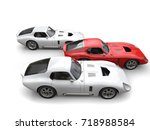 red and white vintage race cars ... | Shutterstock . vector #718988584