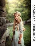portrait of a beautiful blonde... | Shutterstock . vector #718989370