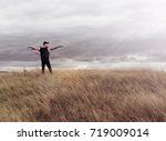 man who feels free  looking at... | Shutterstock . vector #719009014