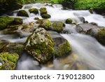 creek with running water in... | Shutterstock . vector #719012800