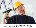 idiot worker using electric... | Shutterstock . vector #719013184