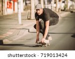 skateboarder ride a skateboard... | Shutterstock . vector #719013424