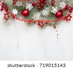 fir branch with christmas...   Shutterstock . vector #719015143