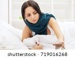 Small photo of Cold And Flu. Woman sleep and hold her head with subliminal stress or other possible symptoms