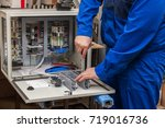 hands of electrician with... | Shutterstock . vector #719016736