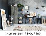 paintings leaning against black ... | Shutterstock . vector #719017480