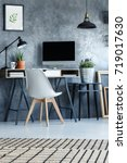 white chair at desk with...   Shutterstock . vector #719017630