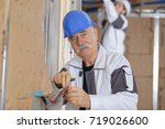 Small photo of electrician installing the wires beforehand