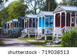 View of german camping place with tents, caravans, trailer park and cabin cottage houses