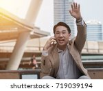 businessman waving hand while... | Shutterstock . vector #719039194