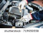 close up of an auto mechanic... | Shutterstock . vector #719050558