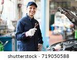 portrait of a smiling mechanic... | Shutterstock . vector #719050588