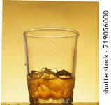 drink with ice cubes in a glass ...   Shutterstock . vector #719056000