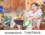young woman holding a burning...   Shutterstock . vector #719073019