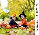 children in black and orange... | Shutterstock . vector #719078980