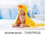 happy laughing baby wearing... | Shutterstock . vector #719079523