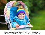 baby in stroller on a walk in...   Shutterstock . vector #719079559