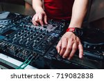 hands dj mixing music at the... | Shutterstock . vector #719082838