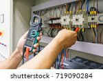 electrical engineer adjusts... | Shutterstock . vector #719090284