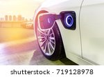 electric car charging on... | Shutterstock . vector #719128978