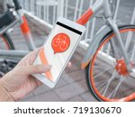 smart phone and shared bikes | Shutterstock . vector #719130670