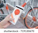 smart phone and shared bikes | Shutterstock . vector #719130670