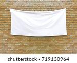 cloth banner hanging on brick... | Shutterstock . vector #719130964