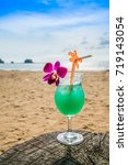 blue hawaiian cocktail with... | Shutterstock . vector #719143054