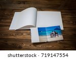 open book with a photo couples... | Shutterstock . vector #719147554