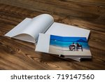 open book with a photo couples... | Shutterstock . vector #719147560
