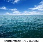 blue sea water surface on sky | Shutterstock . vector #719160883