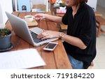 business  woman holding digital ... | Shutterstock . vector #719184220