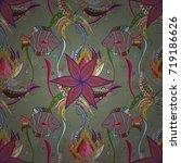 doodle flowers seamless pattern.... | Shutterstock .eps vector #719186626