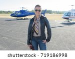 woman going in an helicopter | Shutterstock . vector #719186998