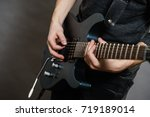 male hands with electric guitar.... | Shutterstock . vector #719189014