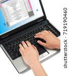 using a laptop | Shutterstock . vector #719190460