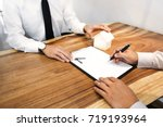 real estate agent with customer ... | Shutterstock . vector #719193964