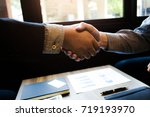 business colleagues hand shaking | Shutterstock . vector #719193970