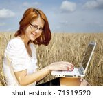 Young Businesswomen in white working with notebook at wheat field. - stock photo
