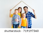 family moving into new house | Shutterstock . vector #719197360
