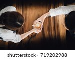 a couple holding coffee on the... | Shutterstock . vector #719202988